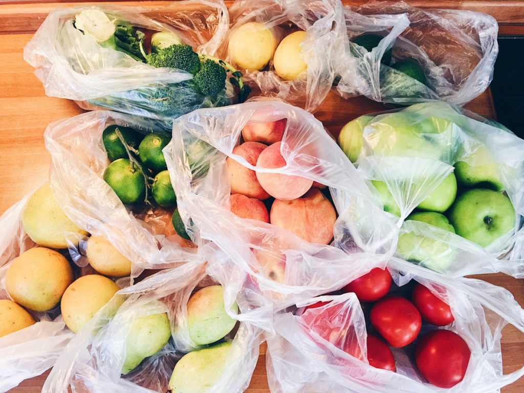 fruits and veggies in plastic bags